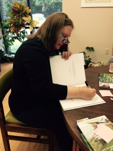 Heather Bass at book signing at the Wiggins Library.